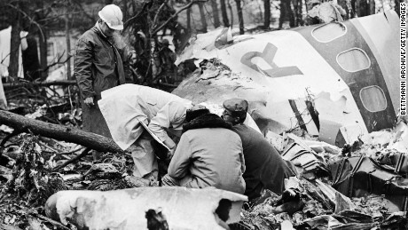 Rescue workers search the wreckage of a plane crash in Huntington, West Virginia. The plane carried the Marshall University football team and all passengers were killed.