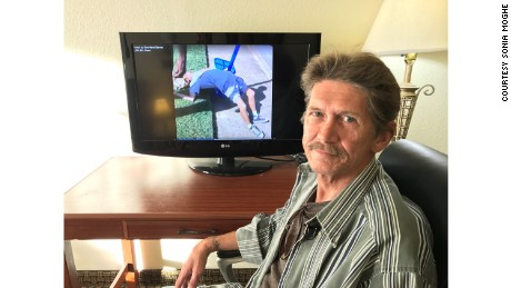Ronald Hiers watches the video of himself and his wife overdosing on heroin.