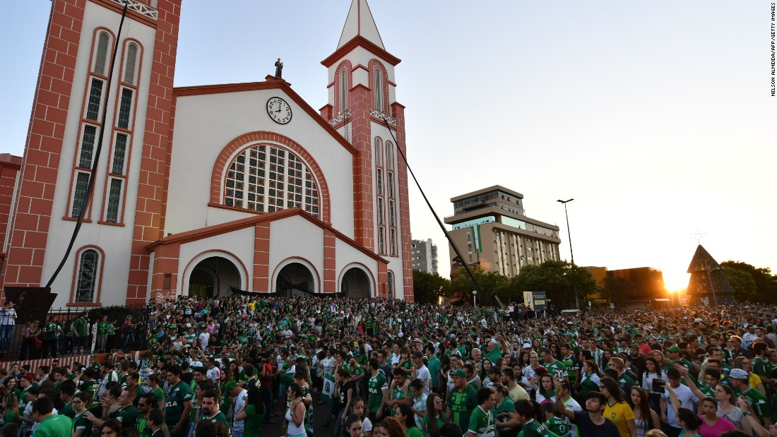 People surround a church during a memorial Mass in Chapeco on November 29.
