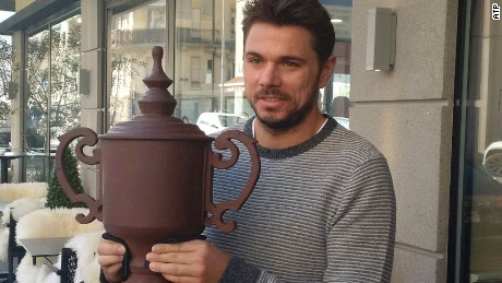 Stan Wawrinka holds the US Open chocolate replica gifted to him at the launch of the 2017 Geneva Open.