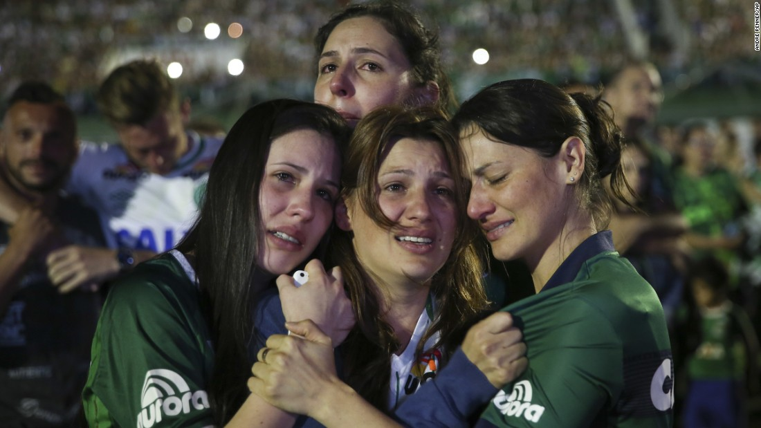 Relatives of Chapecoense soccer players cry during the tribute on November 30.