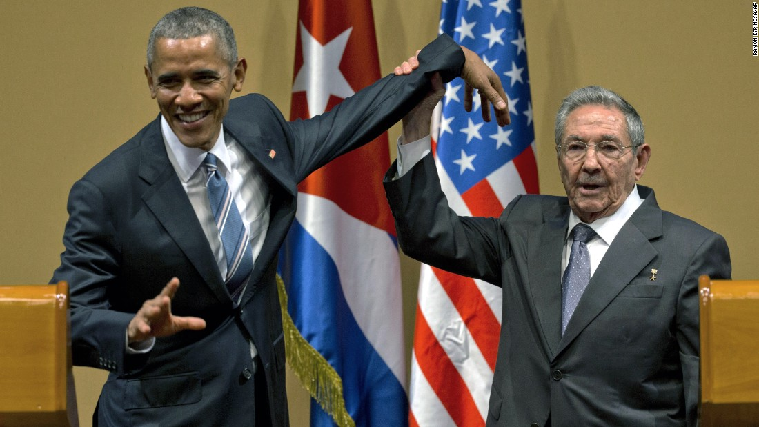 "<strong>March 21:</strong> Cuban President Raul Castro tries to lift up the arm of US President Barack Obama at the end of <a href=""http://www.cnn.com/2016/03/21/politics/obama-cuban-raul-castro/"" target=""_blank"">a joint news conference</a> in Havana, Cuba. Though they both acknowledged deep disagreements on human rights, political prisoners and economic reforms, the two leaders found common ground on the topic of the economic embargo on Cuba, which both want lifted. Obama went so far as to declare that ""the embargo's going to end,"" though he couldn't say when."