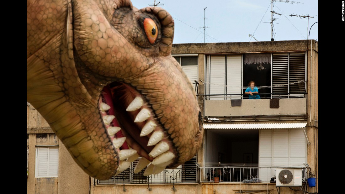 <strong>March 24:</strong> A dinosaur balloon floats through Petah Tikva, Israel, during a parade for the Jewish holiday of Purim.
