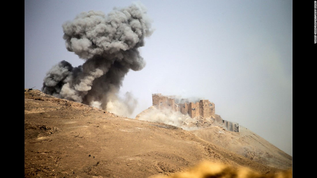"<strong>March 25:</strong> Smoke rises in Palmyra, Syria, where the Syrian army was battling ISIS militants. Syrian forces <a href=""http://www.cnn.com/2016/03/27/world/gallery/retaking-palmyra/index.html"" target=""_blank"">recaptured the city</a> a couple days later. It had been in ISIS' hands for months."