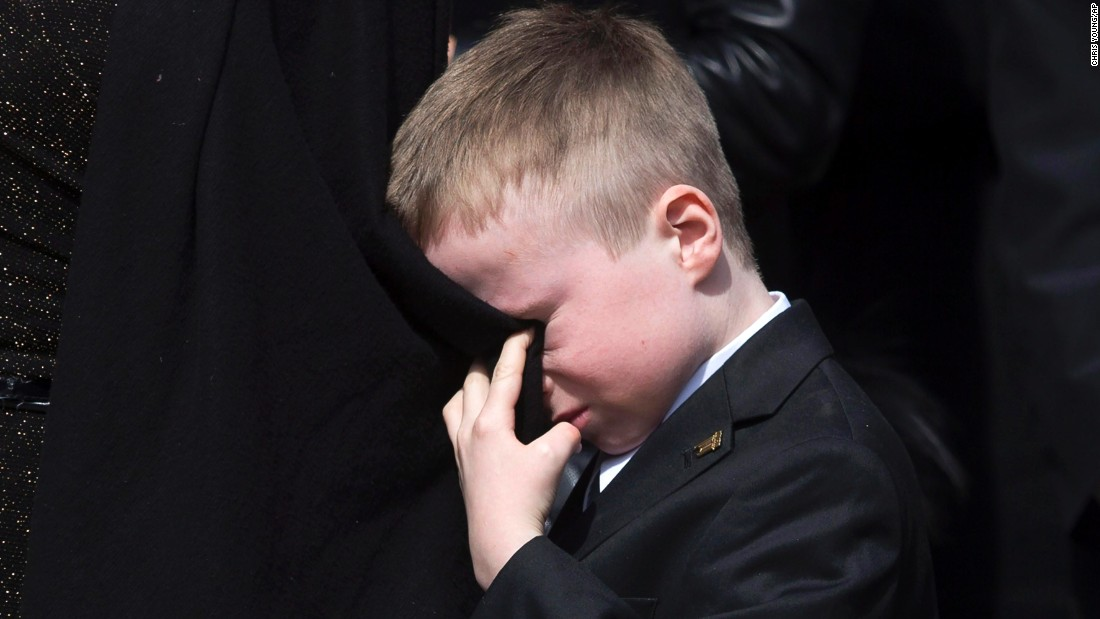 "<strong>March 30: </strong>Doug Ford cries into his mother's coat as he watches the casket of his father, former Toronto Mayor Rob Ford, being placed into a hearse. Rob Ford <a href=""http://www.cnn.com/2016/03/22/us/rob-ford-dies/"" target=""_blank"">died of cancer</a> at the age of 46."