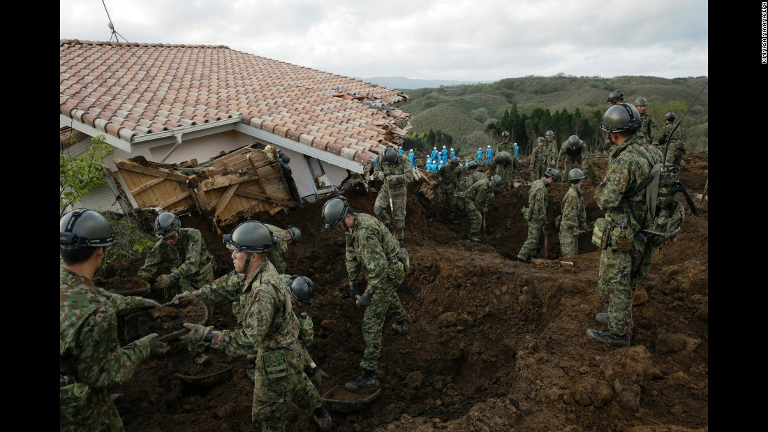 "<strong>April 17:</strong> Rescue workers search for missing people after <a href=""http://www.cnn.com/2016/04/16/asia/japan-earthquake/"" target=""_blank"">a magnitude-7.0 earthquake</a> caused a landslide in Japan's Kumamoto Prefecture. A magnitude-6.2 quake rattled the area two days earlier."