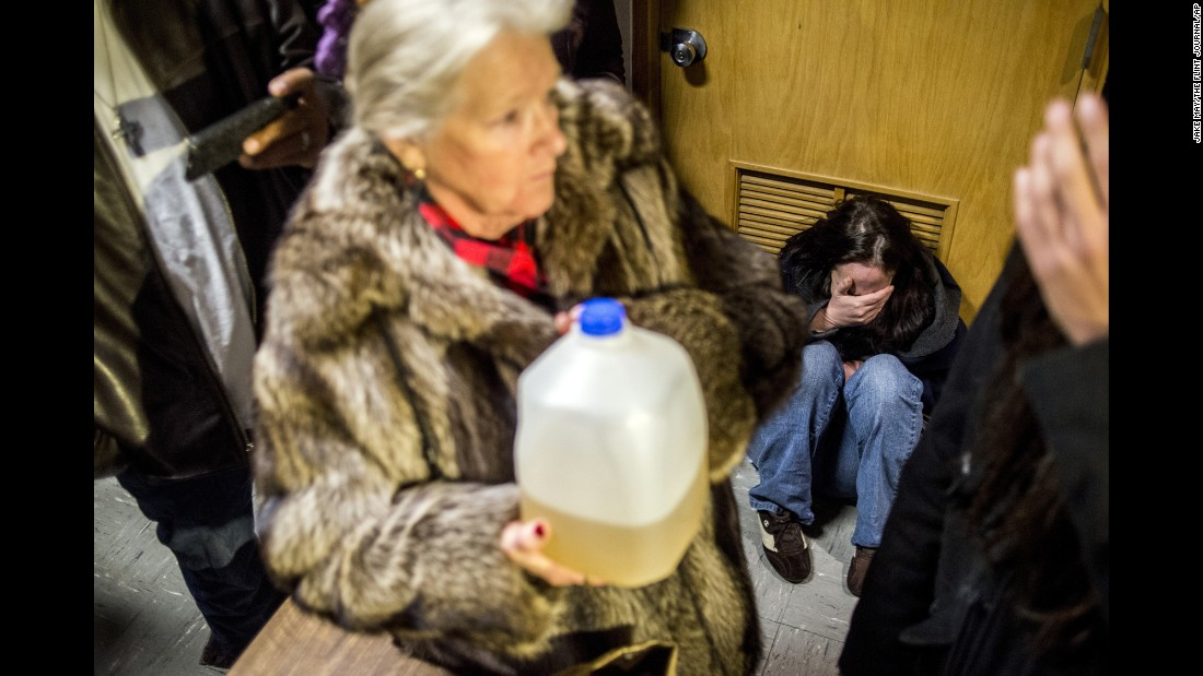 "<strong>January 11: </strong>Andrew Watson, a resident of Flint, Michigan, drops to the floor in tears outside the doors to Flint's City Council. Michigan Gov. Rick Snyder was holding a news conference there about <a href=""http://www.cnn.com/interactive/2016/05/health/focus-on-flint/"" target=""_blank"">the city's water crisis.</a> Snyder had declared a state of emergency three months after high lead levels were detected in Flint children."