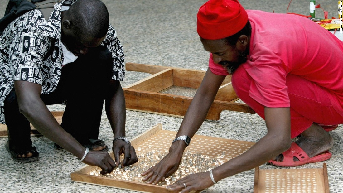 Counting is snappy as the marbles are poured from the ballot drum into a wooden tray with 200 or 500 holes.
