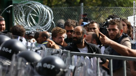 Ahmed H. speaking to riot police from behind a blockade on September 16, 2015.