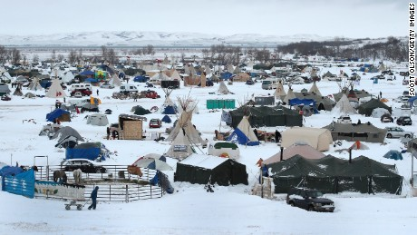 CANNON BALL, ND - NOVEMBER 30:  Snow covers Oceti Sakowin Camp near the Standing Rock Sioux Reservation on November 30, 2016 outside Cannon Ball, North Dakota. Native Americans and activists from around the country have been gathering at the camp for several months trying to halt the construction of the  Dakota Access Pipeline. The proposed 1,172 mile long pipeline would transport oil from the North Dakota Bakken region through South Dakota, Iowa and into Illinois.  (Photo by Scott Olson/Getty Images)