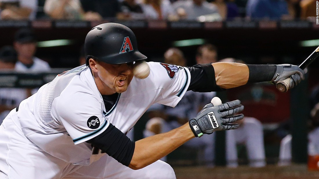 Arizona shortstop Nick Ahmed fouls a pitch off his face during a Major League Baseball game in Phoenix on Friday, April 22. He shook off the pain and got a base hit.