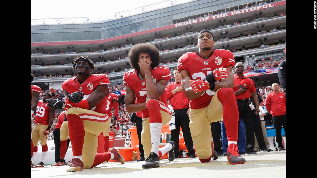 "From left, San Francisco 49ers Eli Harold, Colin Kaepernick and Eric Reid kneel in protest during the national anthem on Sunday, October 2. Since the beginning of the season, Kaepernick <a href=""http://www.cnn.com/2016/09/01/sport/nfl-preseason-49ers-chargers-colin-kaepernick-national-anthem/"" target=""_blank"">has refused to stand during the national anthem</a> because he will not ""show pride in a flag for a country that oppresses black people and people of color."""