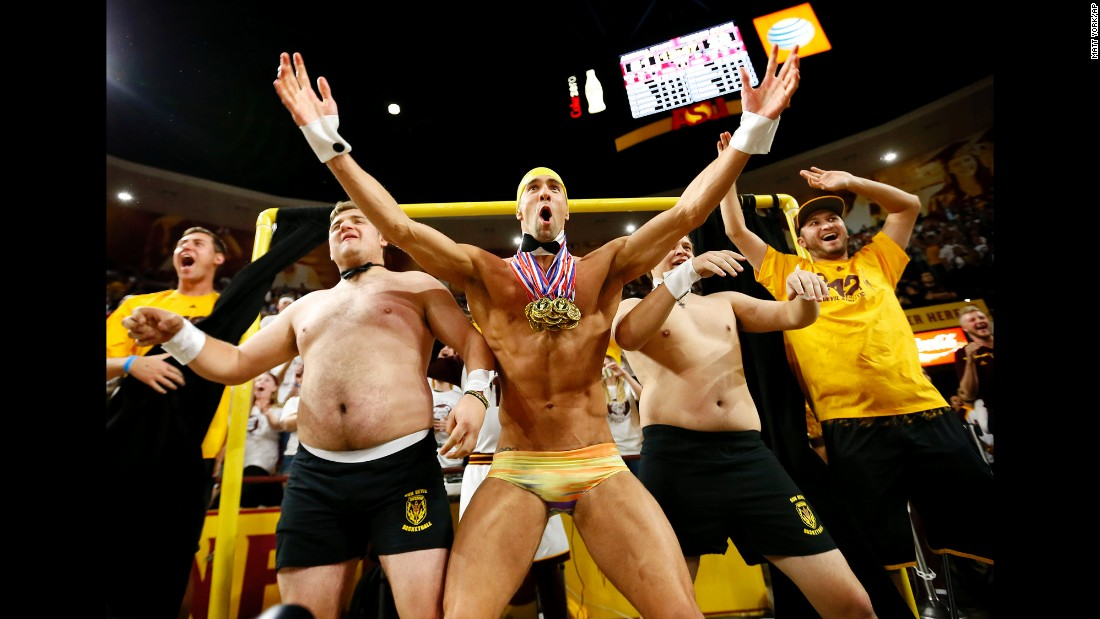 "Olympic legend Michael Phelps helps Arizona State students try to distract a free-throw shooter during a college basketball game on Thursday, January 28. The Oregon State shooter missed both of his shots after Phelps <a href=""http://bleacherreport.com/articles/2612010-michael-phelps-pops-out-of-asus-curtain-of-distraction-to-distract-ft-shooter"" target=""_blank"">popped out of the ""Curtain of Distraction.""</a>"