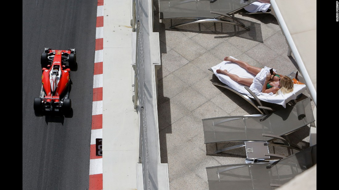 A woman sunbathes during a Formula One practice session in Monaco on Thursday, May 26.