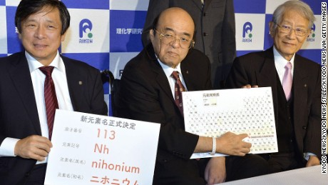 "Kyushu University Professor Kosuke Morita (C) points to the ""nihonium"" on a periodic table during a press conference in the southwestern Japan city of Fukuoka on Dec. 1, 2016."