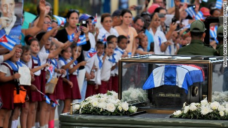 The urn with the ashes of Cuban leader Fidel Castro is driven through the streets of Holguin, on December 2, 2016 during its four-day journey across the island for the burial in Santiago de Cuba.  A military jeep is taking the ashes of Fidel Castro on a four-day journey across Cuba, with islanders lining the roads to bid farewell to the late communist icon. Castro died at 90 on November 25, 2016 and will be buried in the eastern city of Santiago de Cuba on December 4. / AFP / YAMIL LAGE        (Photo credit should read YAMIL LAGE/AFP/Getty Images)