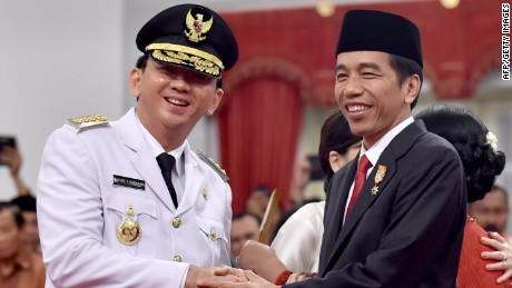 Indonesian President Joko Widodo, right, congratulates  the Jakarta governor at his swearing-in in 2014.