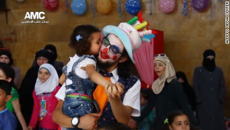 A little girl gives Anas al-Basha a kiss on the cheek during Eid celebrations in July 2015.