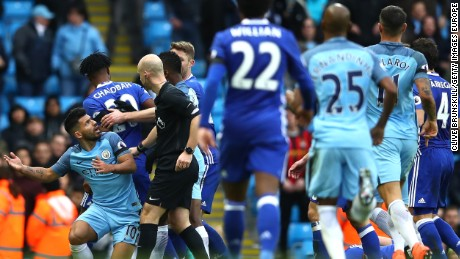 Players from both sides get involved after Sergio Aguero (left) is about to be shown a red card for his challenge on David Luiz of Chelsea.