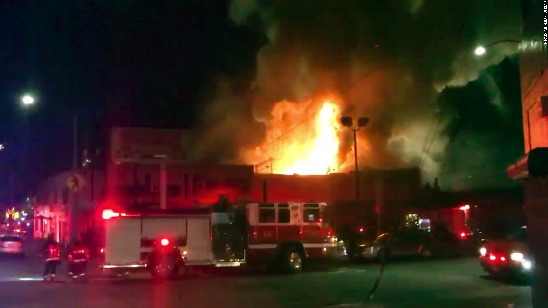 "The scene as firefighters battle the blaze from video footage by <a href=""https://twitter.com/OaklandFireLive"" target=""_blank"">@Oaklandfirelive</a> early Saturday, December 3."