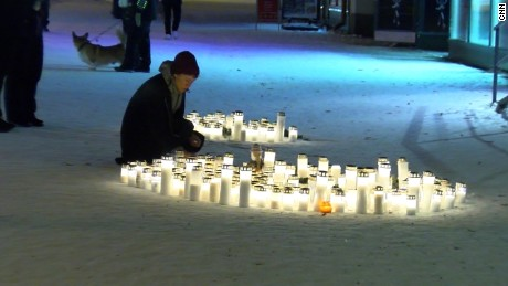 A candlelight vigil at the scene of the shooting.