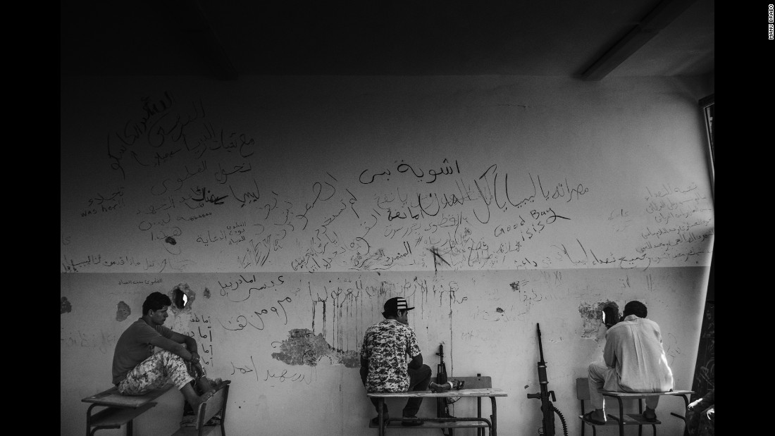 Libyan fighters hold a defensive position inside a school.