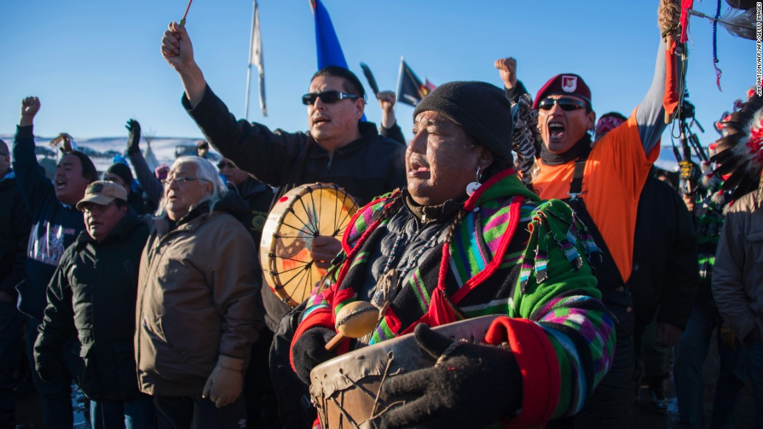 Activists celebrate at Oceti Sakowin Camp on December 4. An executive order by President Donald Trump in January allows work to resume on the Dakota Access Pipeline, which the activists oppose.