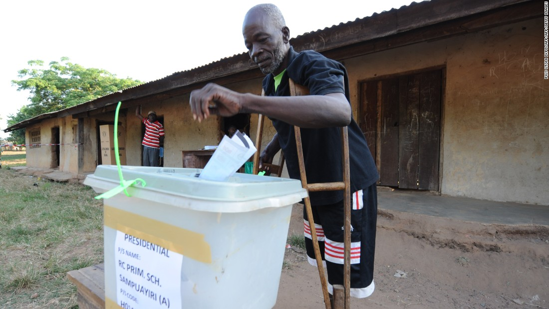 A man on crutches casts his vote at Talekura, Bole Bamboi constituency, in a northern region on December 7, 2012 during the presidential elections
