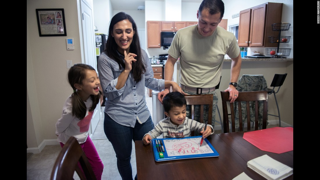 The Gates family cheers on Evan, who has just drawn his first happy face.