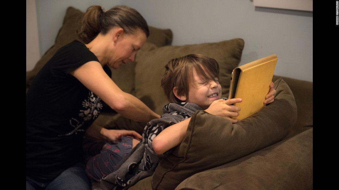 "Samantha Jones and her family live in Grass Valley, California. Both of her sons have type 1 diabetes. On this morning, Samantha changes the insulin pump for her younger son, Emmett. Every night, Samantha sleeps with the boys' continuous glucose monitor receivers to monitor their blood sugar levels. Most nights for the past 10 years, she has gotten up three for four times to give them insulin or juice. ""Get up and do it all over again. Every single day,"" she says."