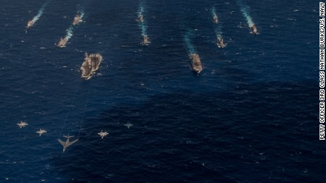 A B-1 bomber from the 34th Expeditionary Bomb Squadron leads a formation with fighters in front of U.S. Navy and Japanese surface vessels during Exercise Keen Sword 17 in the Pacific last month.
