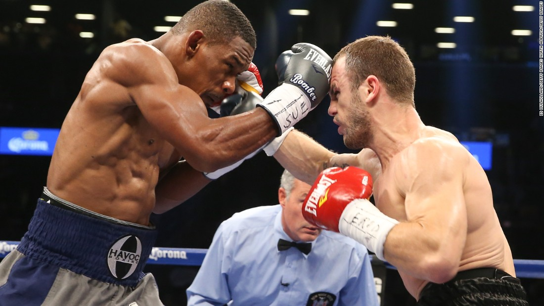 "Pictured, Jacobs winning his world Middleweight crown against Jarrod Fletcher, in August 2014. Rozier never doubted that Jacobs would become world champion. ""His battle with cancer was truly the hardest battle he could ever face. Everything else was a walk in the park,"" he said.<br />"