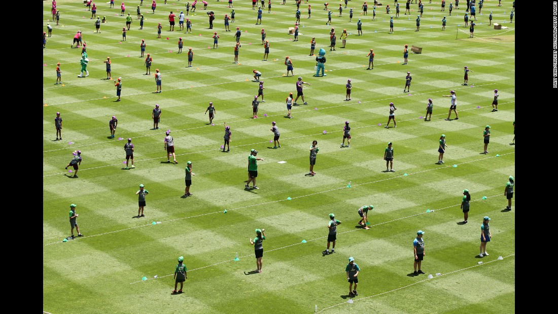 Children take part in the Junior Guinness World Record attempt for the largest cricket lesson in Sydney on Friday, December 2.