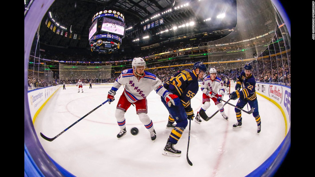 Buffalo and New York players battle for the puck during an NHL hockey game in Buffalo, New York, on Thursday, December 1. New York lost 3-4.