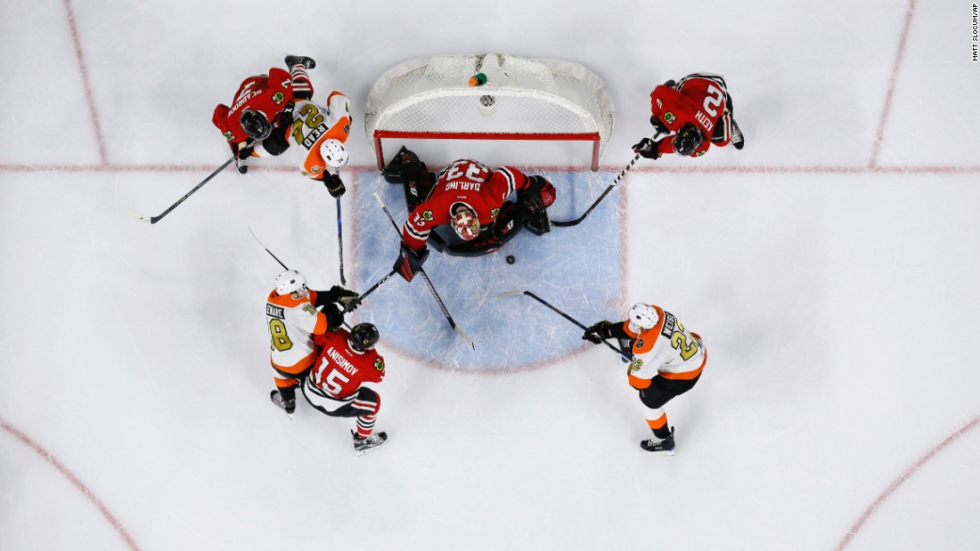 Chicago and Philadelphia players go for the puck during the second period of an NHL hockey game in Philadelphia on Saturday, December 3. Philadelphia defeated Chicago 3-1.