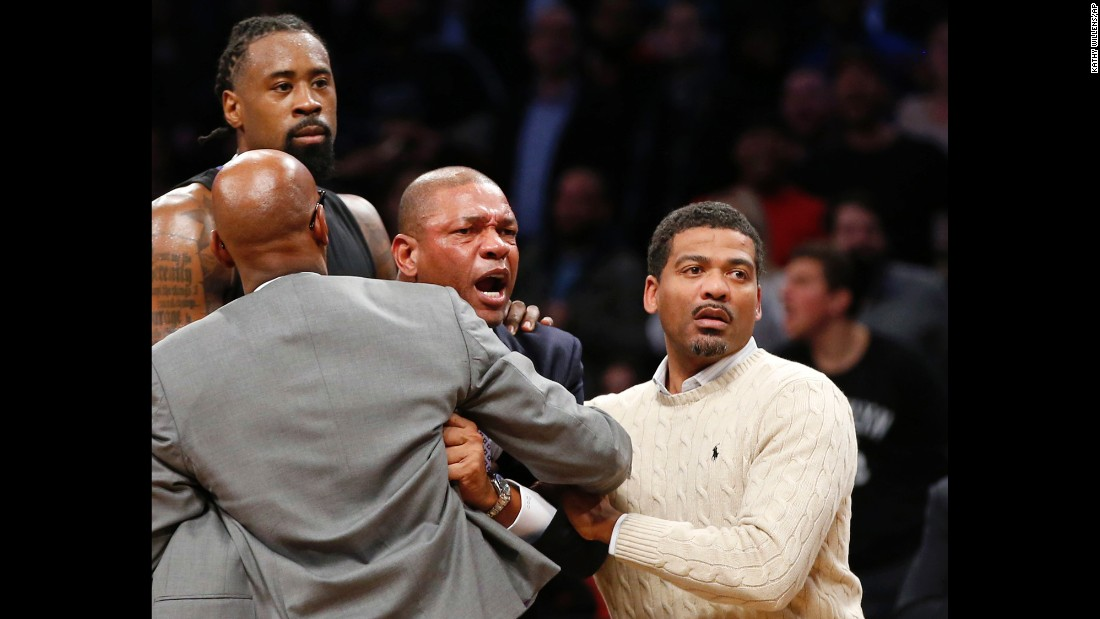 Los Angeles coach Doc Rivers, second from right, is restrained after objecting to a call in the second overtime during an NBA game against Brooklyn in New York on Tuesday, November 29. Los Angeles lost to Brooklyn 122-127.