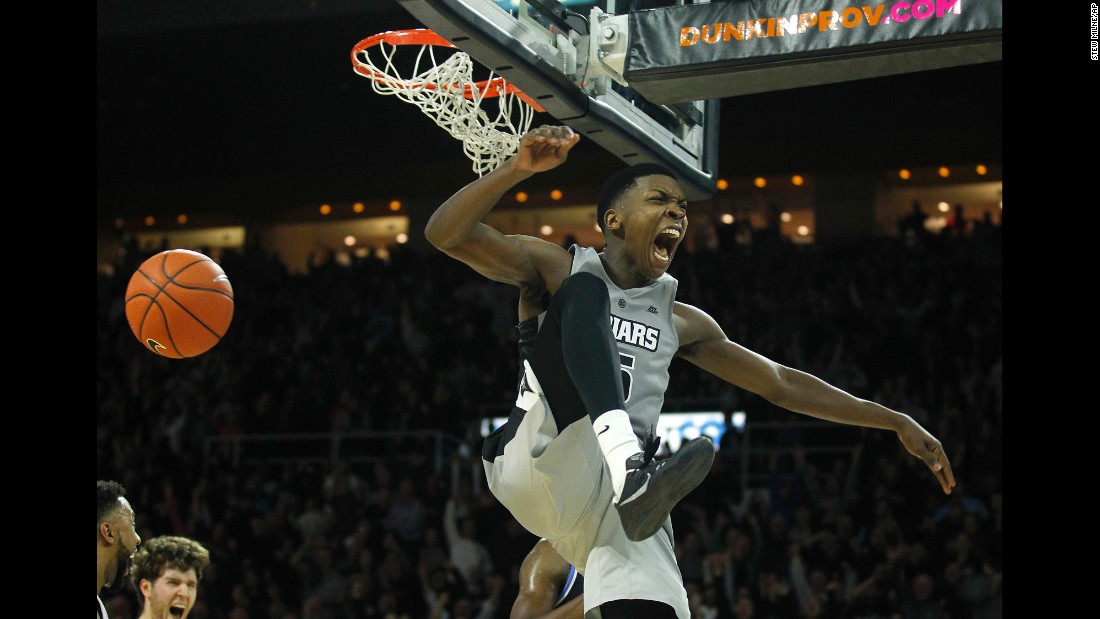 Providence's Rodney Bullock celebrates a slam dunk against Rhode Island during the second half of an NCAA basketball game in Providence, Rhode Island, on Saturday, December 3. Providence defeated Rhode Island 63-60.