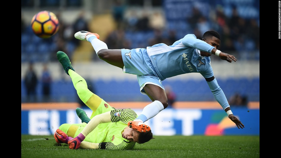 Lazio's Keita Balde Diao, in blue, attempts to score against Roma goalkeeper Wojciech Szczęsny during an Italian league match in Rome on Sunday, December 4. Roma won 2-0.