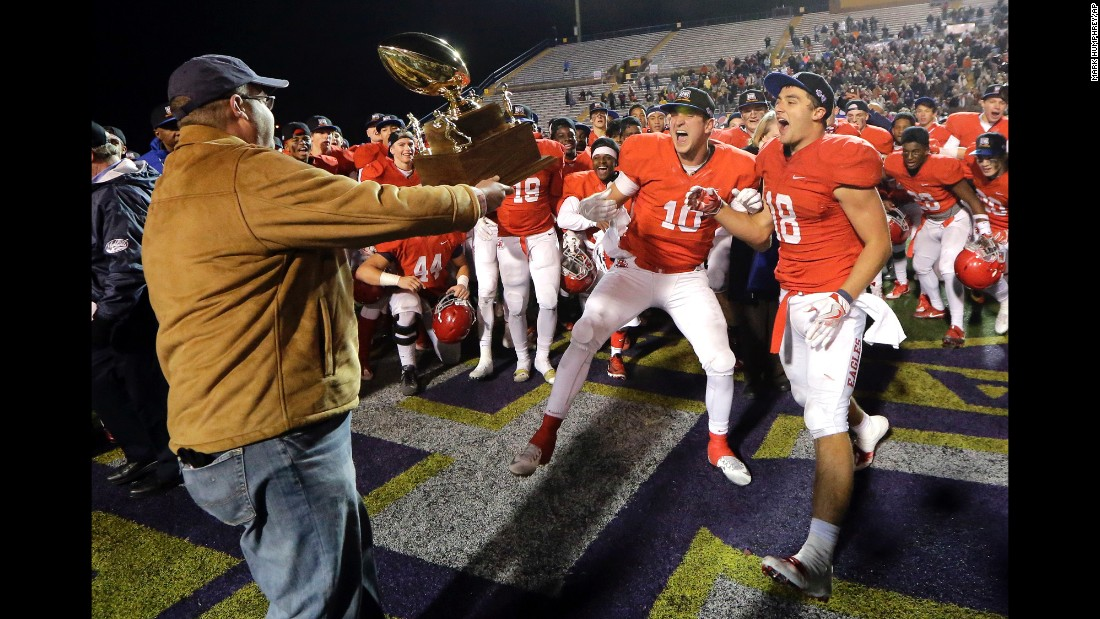 Brentwood Academy football players celebrate winning a high school football championship game in Cookeville, Tennessee, on Thursday, December 1. Brentwood Academy defeated Montgomery Bell Academy 42-38.