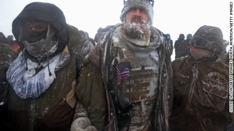 "Despite blizzard conditions, military veterans march in support of the ""water protectors"" at Oceti Sakowin Camp."