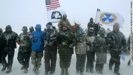 Veterans march on the edge of the Standing Rock Sioux Reservation on December 5, 2016.
