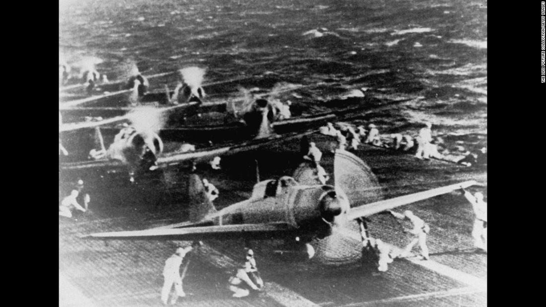 Crewmen of the Japanese Hiryu aircraft carrier prepare fighter planes for takeoff before the raid on Pearl Harbor.<br />