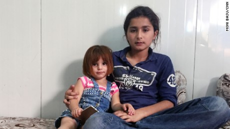 Ahmed Mushal Hassan's son Yousif, right, and daughter Asal were away from home when ISIS took over Mosul.