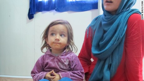 Isra Aksram and one of her three children; the family fled Bartella when ISIS overran their hometown.