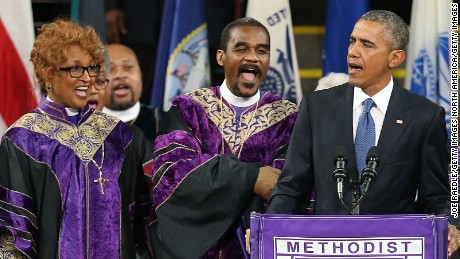 "CHARLESTON, SC - JUNE 26:  U.S. President Barack Obama sings ""Amazing Grace"" as he delivers the eulogy for South Carolina state senator and Rev. Clementa Pinckney during Pinckney's funeral service June 26, 2015 in Charleston, South Carolina. Suspected shooter Dylann Roof, 21, is accused of killing nine people on June 17th during a prayer meeting in the church, which is one of the nation's oldest black churches in Charleston.  (Photo by Joe Raedle/Getty Images)"
