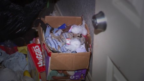 Authorities say the home was filled with clutter and soiled laundry.