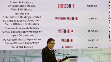 The president of the National Hydrocarbons Commission, Juan Carlos Zepeda, speaks during the auction for the Trion oilfild at the Centro Banamex, which BHP won with an investment of 624 million dollars, in Mexico City on December 5, 2016.  / AFP / ALFREDO ESTRELLA        (Photo credit should read ALFREDO ESTRELLA/AFP/Getty Images)