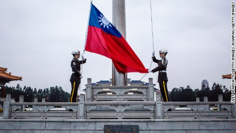 TAIPEI, TAIWAN - JANUARY 14:  Honor guards raise the Taiwan flag in the Chiang Kai-shek Memorial Hall square ahead of the Taiwanese presidential election on January 14, 2016 in Taipei, Taiwan. Voters in Taiwan are set to elect Tsai Ing-wen, the chairwoman of the opposition Democratic Progressive Party, to become the island's first female leader.  (Photo by Ulet Ifansasti/Getty Images)