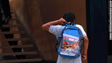 "A secondary school student walks carrying his new transparent backpack  in Guadalajara, Mexico on October 25, 2012. The transparent backpacks are part of the program ""Escuela Segura"" (Safe School ) to avoid violence in schools and in the coming days the State Government will deliver 10,000 more of these hoping the measure will help teachers and parents see what students are taking to school. AFP PHOTO/Hector Guerrero        (Photo credit should read HECTOR GUERRERO/AFP/Getty Images)"