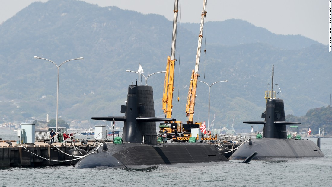 Japan Maritime Self-Defense Forces submarines are moored at a pier in Kure, Hiroshima prefecture on April 12, 2016. Japan has 18 submarines.